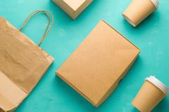 Flat lay recyclable types of paper packaging on a blue background, paper bag, disposable glass, cardboard box. Top view flat lay recyclable types of paper stock images