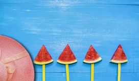 Top view, flat lay, skewers of watermelon slices and mint with hat on bright blue wood background,concept organic fruit  non-toxic. For health,for refreshing stock images