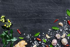 Top view of food ingredients and condiment on the table, Ingredients and seasoning on dark wooden floor Stock Images