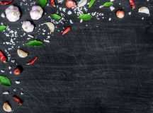 Top view of food ingredients and condiment on the table, Ingredients and seasoning on dark wooden floor Stock Photos