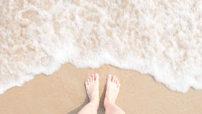 Top view foot on beach with Blur and soften Sea foam, Hipster style Royalty Free Stock Images