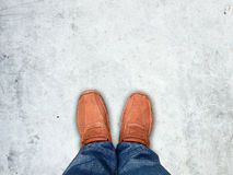 Top view ,Foot stand on concrete floor,Leave space for your cont Stock Photos