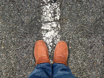 Top view,Foot stand on road ,Leave space for your content Royalty Free Stock Photo