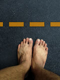 Top view ,Foot stand on the road surface Royalty Free Stock Images