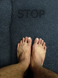 Top view ,Foot stand on the road surface Stock Photography