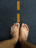 Top view ,Foot stand on the road surface Stock Images