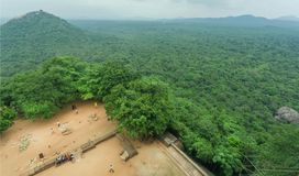 Top view on forest from the ancient Sigiriya rock with tourists and archeological area, Sri Lanka. UNESCO heritage site Royalty Free Stock Image