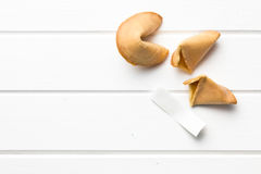 Top view of fortune cookie. On white table Royalty Free Stock Photo