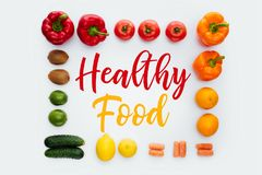 Top view of frame with vegetables and fruits and text Healthy Food. Isolated on white stock image