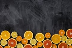 Frame border with citrus at dark background stock photos