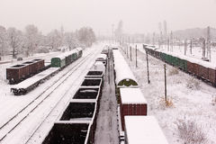Top view of freight train with carriages on railways at winter Stock Photos