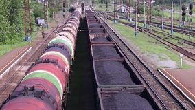 Top view of freight train with tanks and train with coal stock video