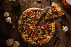 Top view of fresh baked pizza with slice served stock images