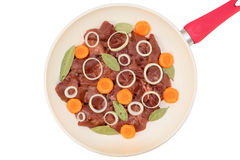 Top view of fresh chicken liver in a white frying pan Royalty Free Stock Images