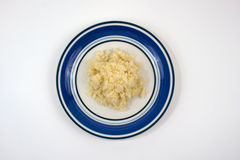 Top View of Fresh Chopped Garlic on Plate. Top view of fresh chopped, minced garlic on blue and white plate stock photos
