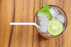 Top view of fresh cocktail with lime slice and mint on wood back Stock Photo