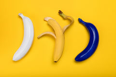 Top view of fresh colored bananas isolated on yellow Royalty Free Stock Images