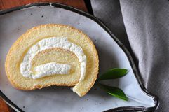 Top view of Fresh Cream Roll Cake. On plate royalty free stock photos