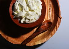 A top view of fresh curd on clay pot with palm tree leaf plate Royalty Free Stock Photos