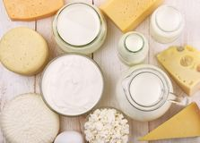 Top view of fresh dairy products. On wooden table Royalty Free Stock Images