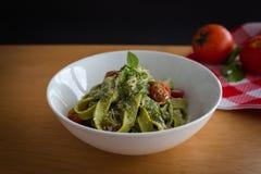 Fresh pasta pesto with tomatoes stock image
