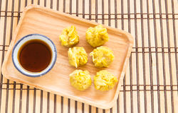Top view fresh dumplings with hot steams on wood plate. Chinese food on wooden background Royalty Free Stock Images