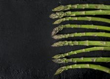 Asparagus on rustic black background Royalty Free Stock Image