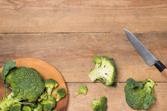 Top view of Fresh green broccoli on rustic wooden background - h. Ealthy or vegetarian food Royalty Free Stock Images