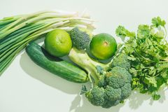 Top view of fresh green vegetables on green background.  Royalty Free Stock Images