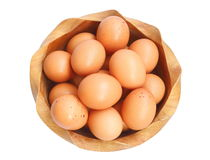 Top view of fresh home grown eggs in wooden bowl Royalty Free Stock Images
