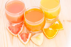 Top view of fresh juice in glass with pieces of various fruits. Stock Photography