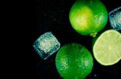 Top of view of fresh lime with ice cubes and space for text Stock Photos