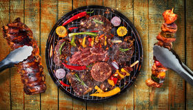Top view of fresh meat and vegetable on grill placed on wooden p royalty free stock photography