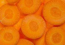 Top view of fresh orange carrot slice background. Top view of fresh orange carrot slice background Stock Photo