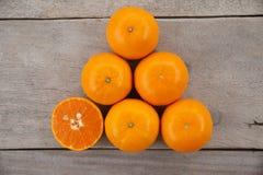 Top view fresh orange fruits on wooden table stock photos