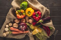Fresh picked vegetables on sacking. Top view of fresh picked organic ripe vegetables on sacking stock image