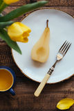 Top View of Fresh Poached Pear on White Plate Royalty Free Stock Photography