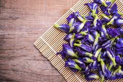 Free Top View Fresh Purple Butterfly Pea Flower On Wooden Board Background Royalty Free Stock Photography - 115628907