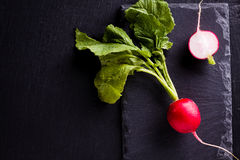 Top view of fresh radish. Lay on black slate plate Stock Images