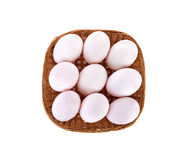 Top view fresh raw duck eggs in bamboo basket and on white backg Royalty Free Stock Photos