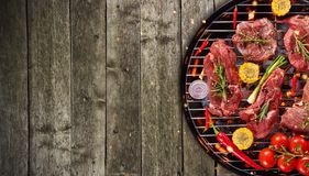 Top view of fresh raw meat and vegetable on grill placed on wood. En floor. Barbecue, grill and food concept Stock Photography