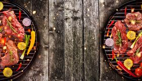 Top view of fresh raw meat and vegetable on grill placed on wood. En floor. Barbecue, grill and food concept Royalty Free Stock Photography