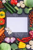 Fresh raw vegetables and blank paper Royalty Free Stock Photography