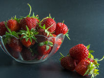 Top view on fresh red strawberries in a basket on black. Background Stock Images