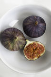 Top view of fresh ripe figs in the ceramic white bowl Royalty Free Stock Image