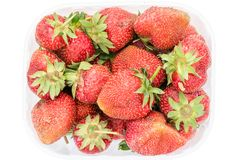 Top view on fresh ripe organic strawberries in transparent plastic retail package. Isolated on white background with clipping path Royalty Free Stock Images
