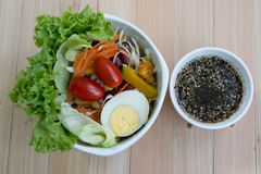 Top view Fresh salad with lettuce, tomato, egg and sesame sauce. Stock Images