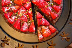 Top view on fresh selfmade baked strawberry cake. Top view on fresh selfmade baked strawberry chocolate cake Stock Image
