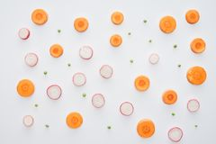 top view of fresh sliced carrot, radish and green peas stock photography