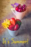 Top view of strawberries, cherries and yellow and purple flowers in bowls on wooden background with a written phrase It`s Summer!. Top view of fresh strawberries Stock Photos